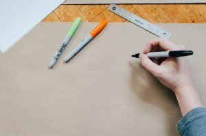 Person getting ready to design sketch on piece of paper