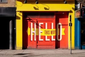 """Hello this way"" design on doorway"